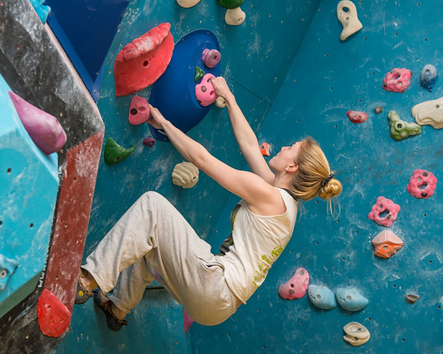 A woman bouldering