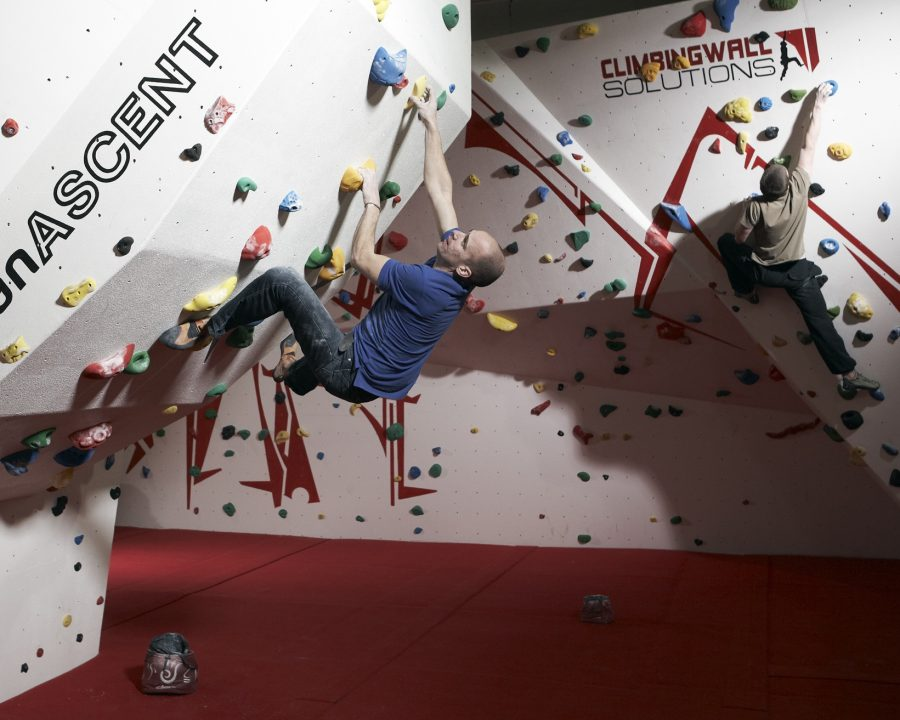 Two climbers on an overhang on a bouldering wall